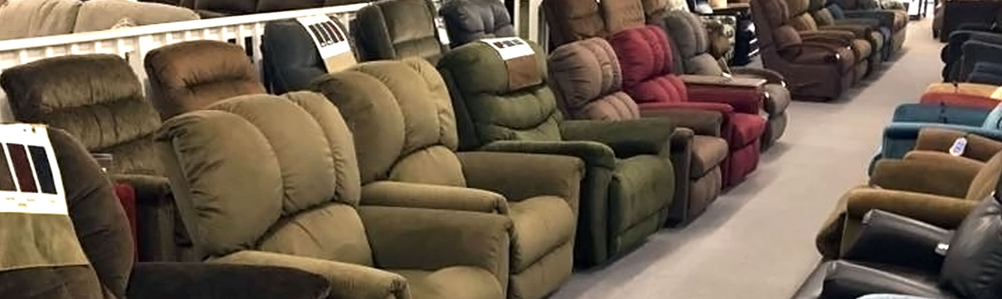 Rows of reclining chairs at Lin Furniture in Little Falls, MN